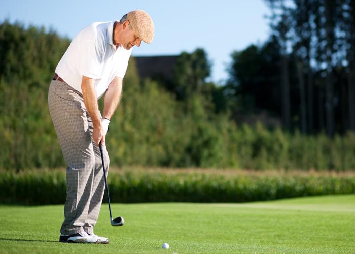 Man playing golf at Hoosier Village