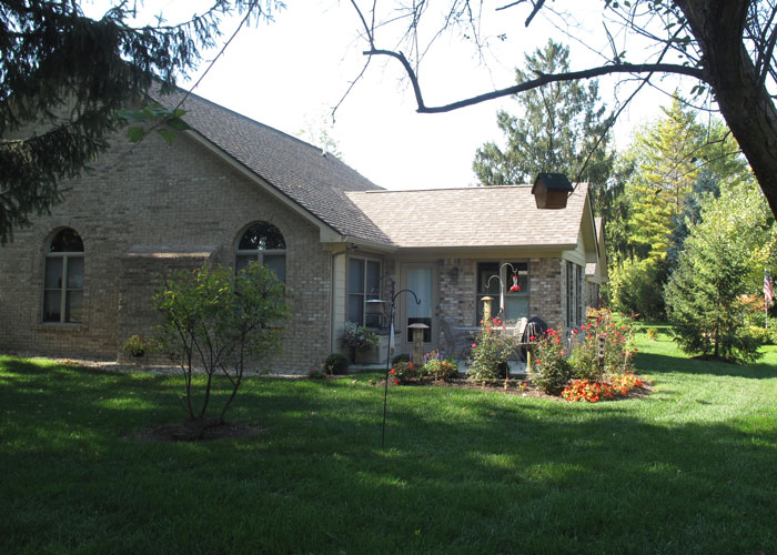 Exterior photo of a private home in Hoosier Village with large shaded yard