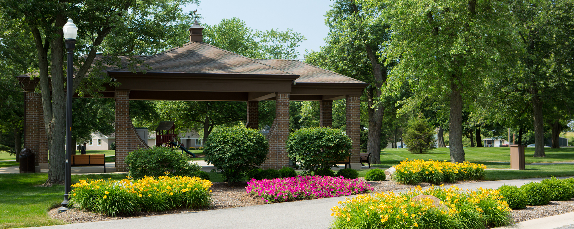 Garden gazebo surrounded by flowers